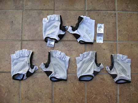 3 Years of white Adistar Gloves: new on top, last year lower left, year prior on lower right