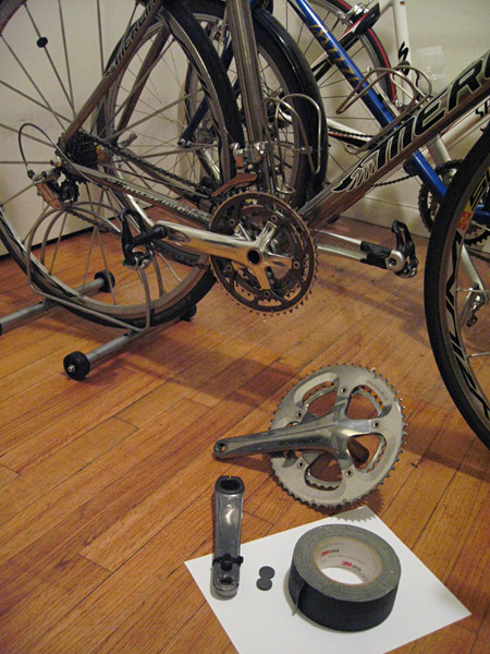 Problem: 53-39 crankset way too big to push up Mt. Washington. Cheap solution: FSA Gossamer triple crankset, refrigerator magnets and gaffer tape