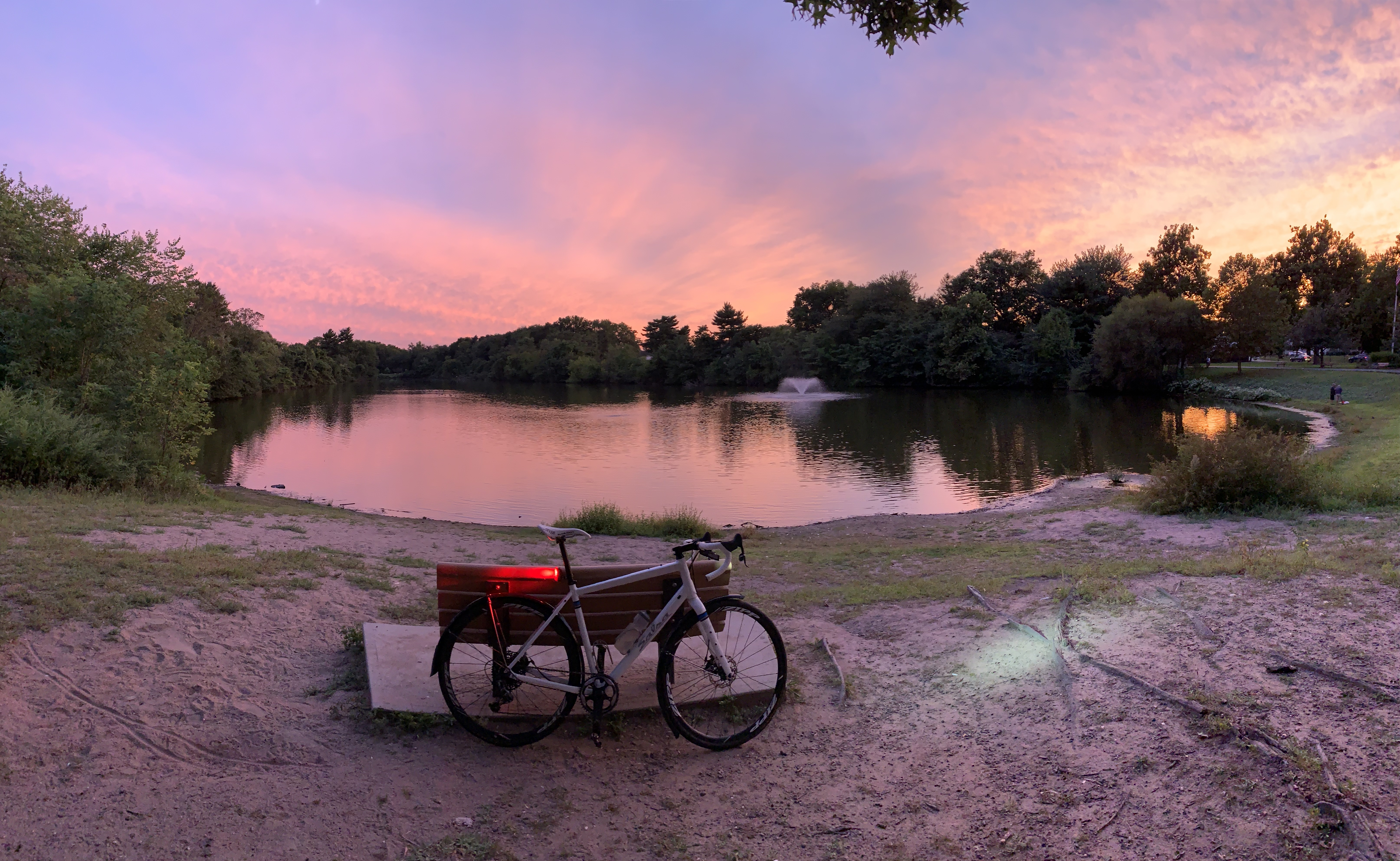 Salsa Journeyman bicycle beside lake at sunset